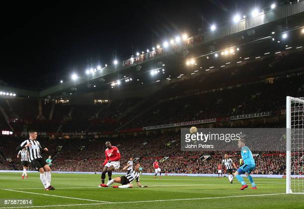 Romelu Lukaku of Manchester United in action with Florian Lejeune of Newcastle United during the Premier League match between Manchester United and...
