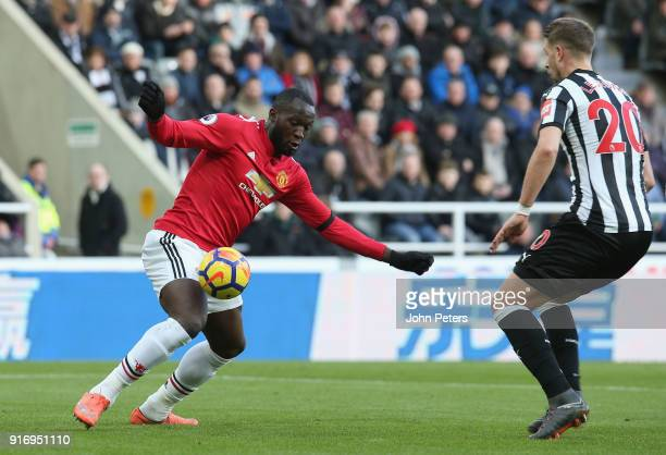 Romelu Lukaku of Manchester United in action with Florian Lejeune of Newcastle United during the Premier League match between Newcastle United and...