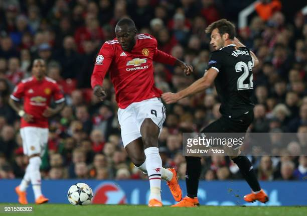 Romelu Lukaku of Manchester United in action with Franco Vazquez of Sevilla FC during the UEFA Champions League Round of 16 Second Leg match between...
