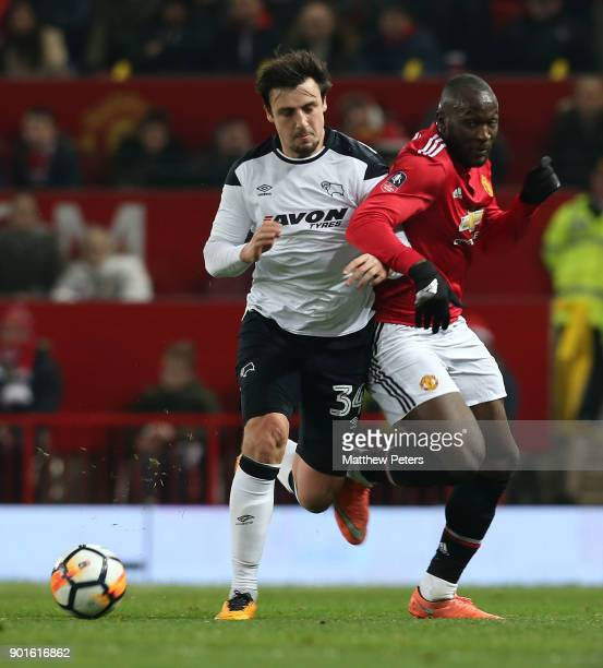 Romelu Lukaku of Manchester United in action with George Thorne of Derby County during the Emirates FA Cup Third Round match between Manchester...