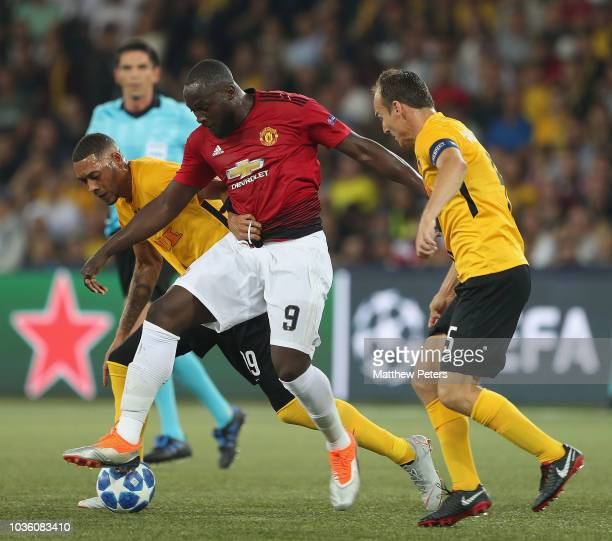 Romelu Lukaku of Manchester United in action with Guillaume Hoarau and Steve von Bergen of BSC Young Boys during the Group H match of the UEFA...