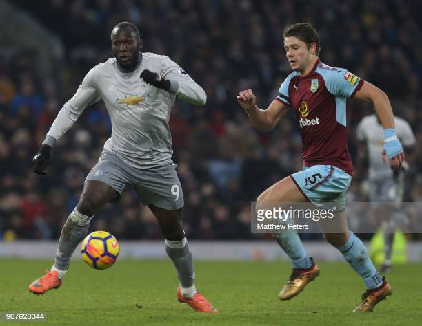 Romelu Lukaku of Manchester United in action with James Tarkowski of Burnley during the Premier League match between Burnley and Manchester United at...