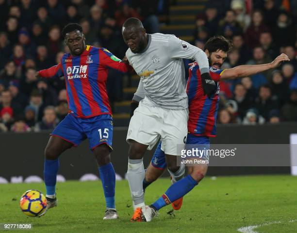 Romelu Lukaku of Manchester United in action with Jeffrey Schlupp and James Tomkins of Crystal Palace during the Premier League match between Crystal...