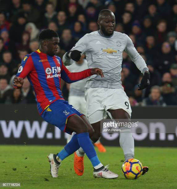 Romelu Lukaku of Manchester United in action with Jeffrey Schlupp of Crystal Palace during the Premier League match between Crystal Palace and...