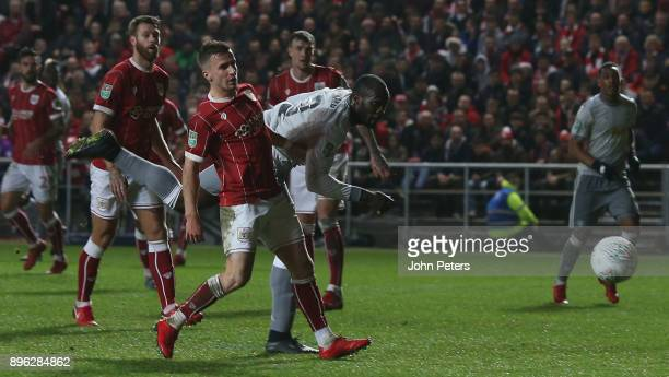 Romelu Lukaku of Manchester United in action with Joe Bryan of Bristol City during the Carabao Cup QuarterFinal match between Bristol City and...