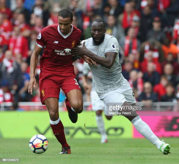 Romelu Lukaku of Manchester United in action with Joel Matip of Liverpool during the Premier League match between Liverpool and Manchester United at...