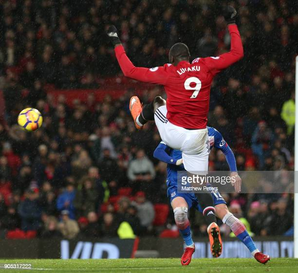 Romelu Lukaku of Manchester United in action with Josh Tymon of Stoke City during the Premier League match between Manchester United and Stoke City...
