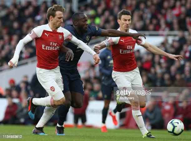 Romelu Lukaku of Manchester United in action with Nacho Monreal and Laurent Koscielny during the Premier League match between Arsenal FC and...