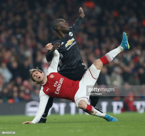 Romelu Lukaku of Manchester United in action with Nacho Monreal of Arsenal during the Premier League match between Arsenal and Manchester United at...