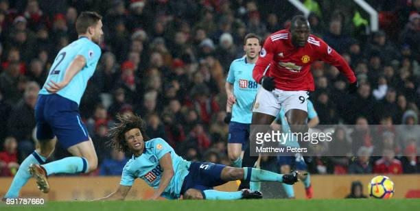 Romelu Lukaku of Manchester United in action with Nathan Ake of AFC Bournemouth during the Premier League match between Manchester United and AFC...