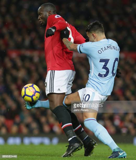 Romelu Lukaku of Manchester United in action with Nicolas Otamendi of Manchester City during the Premier League match between Manchester United and...