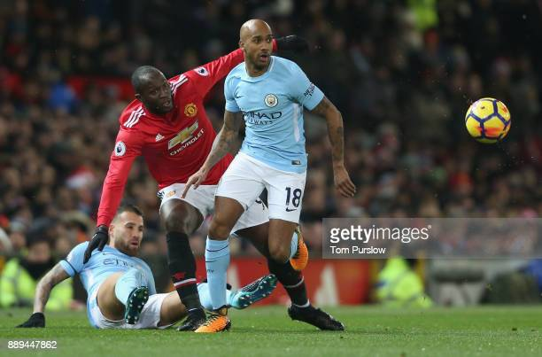 Romelu Lukaku of Manchester United in action with Nicolas Otamendi and Fabian Delph of Manchester City during the Premier League match between...