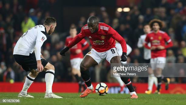 Romelu Lukaku of Manchester United in action with Richard Keogh of Derby County during the Emirates FA Cup Third Round match between Manchester...