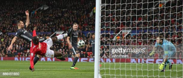 Romelu Lukaku of Manchester United in action with Sergei Ignashevich and Igor Akinfeev of CSKA Moscow during the UEFA Champions League group A match...