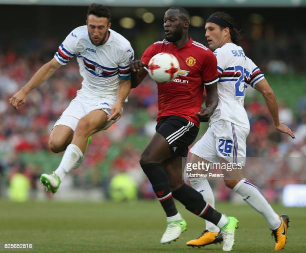 Romelu Lukaku of Manchester United in action with Vasco Regini and Matias Silvestre of Sampdoria during the International Champions Cup preseason...