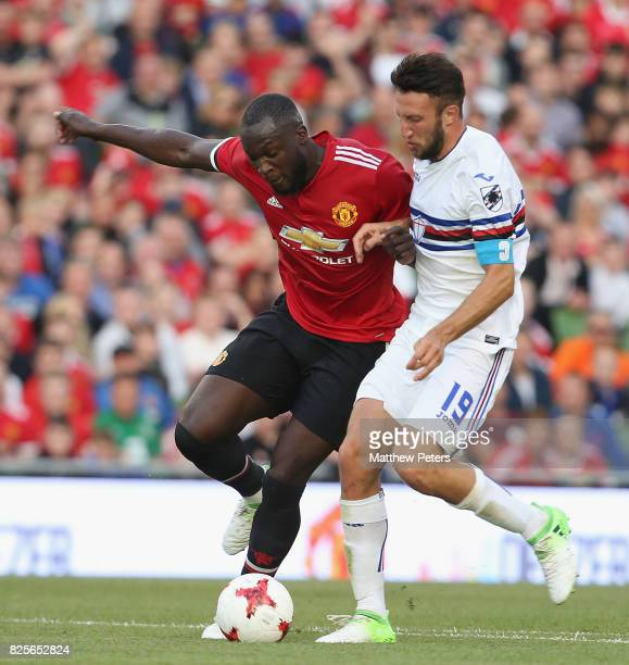 Romelu Lukaku of Manchester United in action with Vasco Regini of Sampdoria during the International Champions Cup preseason friendly match between...