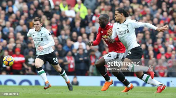 Romelu Lukaku of Manchester United in action with Virgil van Dijk of Liverpool during the Premier League match between Manchester United and...
