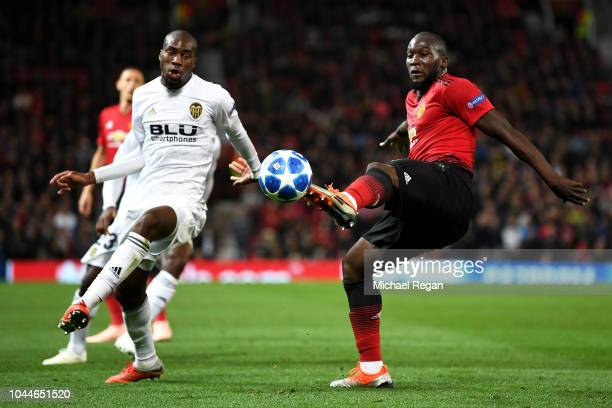 Romelu Lukaku of Manchester United is challenged by Geoffrey Kondogbia of Valencia during the Group H match of the UEFA Champions League between...