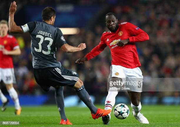 Romelu Lukaku of Manchester United is challenged by Jardel of Benfica during the UEFA Champions League group A match between Manchester United and SL...