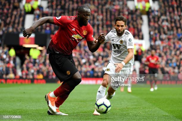 Romelu Lukaku of Manchester United is challenged by Joao Moutinho of Wolverhampton Wanderers during the Premier League match between Manchester...