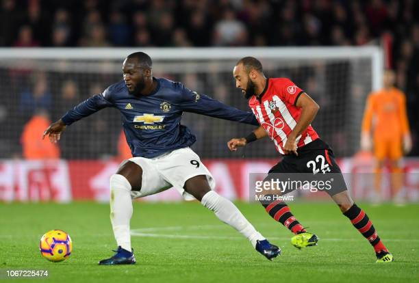 Romelu Lukaku of Manchester United is challenged by Nathan Redmond of Southampton during the Premier League match between Southampton FC and...
