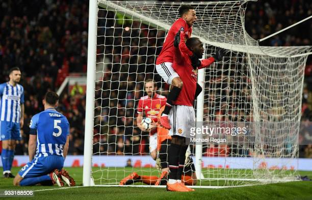 Romelu Lukaku of Manchester United is congratulated after he scores the opening goal during the Emirates FA Cup Quarter Final between Manchester...