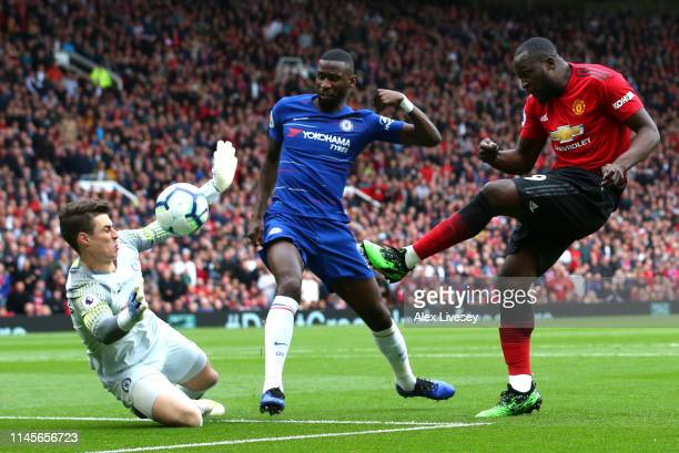 Romelu Lukaku of Manchester United is foiied by Kepa Arrizabalaga and Antonio Ruediger of Chelsea during the Premier League match between Manchester...