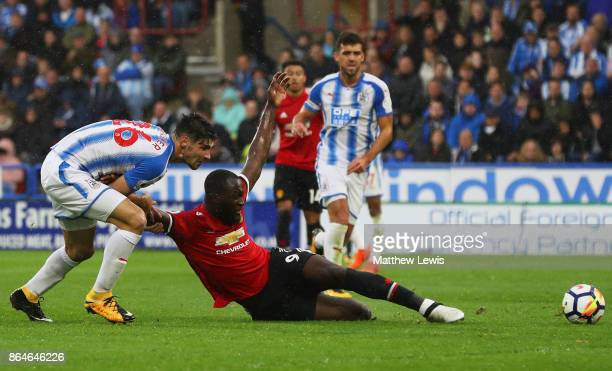 Romelu Lukaku of Manchester United is pulled back by Christopher Schindler of Huddersfield Town during the Premier League match between Huddersfield...
