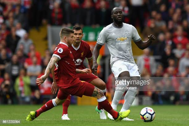 Romelu Lukaku of Manchester United is put under pressure by Alberto Moreno of Liverpool during the Premier League match between Liverpool and...