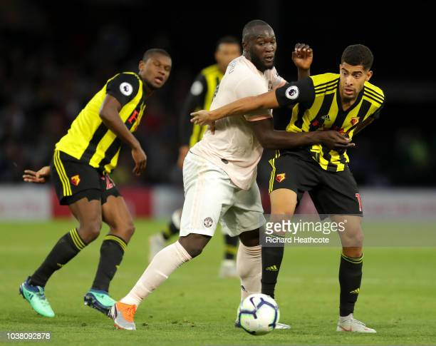 Romelu Lukaku of Manchester United is tackled by Adam Masina of Watford during the Premier League match between Watford FC and Manchester United at...