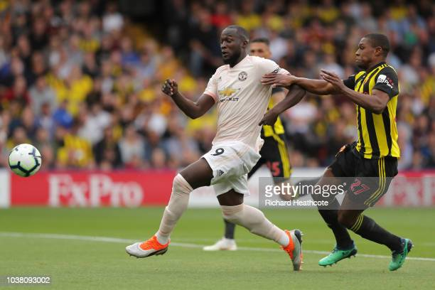Romelu Lukaku of Manchester United is tackled by Christian Kabasele of Watford during the Premier League match between Watford FC and Manchester...