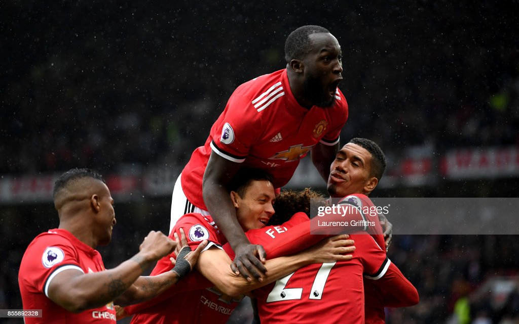 Romelu Lukaku (top) of Manchester United joins the celebration as Marouane Fellaini (2nd R) of Manchester United scroing his side's third goal during the Premier League match between Manchester United and Crystal Palace at Old Trafford on September 30, 2017 in Manchester, England.