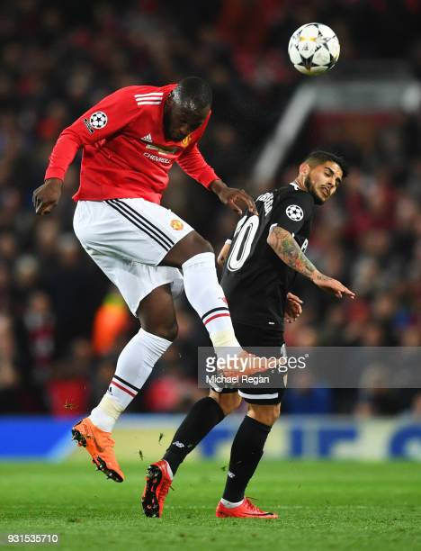 Romelu Lukaku of Manchester United outjumps Ever Banega of Sevilla during the UEFA Champions League Round of 16 Second Leg match between Manchester...