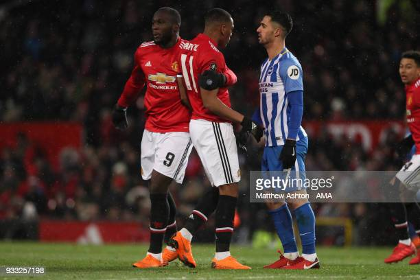 Romelu Lukaku of Manchester United pulls away Anthony Martial as he confronts Beram Kayal of Brighton Hove Albion during the FA Cup Quarter Final...