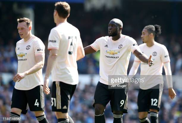 Romelu Lukaku of Manchester United reacts towards team mate Phil Jones during the Premier League match between Everton FC and Manchester United at...