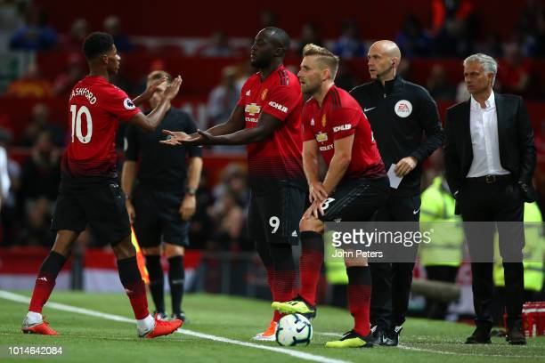 Romelu Lukaku of Manchester United replaces Marcus Rashford during the Premier League match between Manchester United and Leicester City at Old...