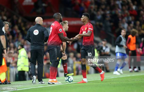 Romelu Lukaku of Manchester United replaces Marcus Rashford of Manchester United during the Premier League match between Manchester United and...