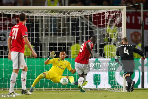 Romelu Lukaku of Manchester United scores his sides first goal past Keylor Navas of Real Madrid during the UEFA Super Cup final between Real Madrid...