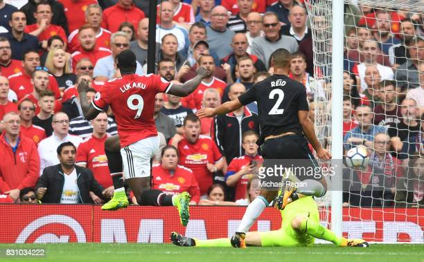 Romelu Lukaku of Manchester United scores his sides first goal past Joe Hart of West Ham United during the Premier League match between Manchester...