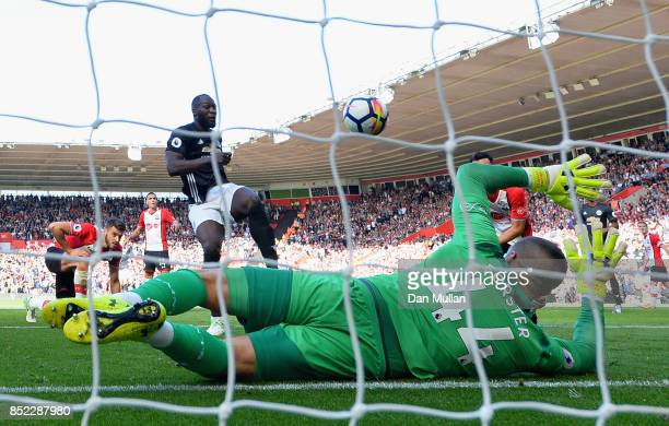 Romelu Lukaku of Manchester United scores his sides first goal past Fraser Forster of Southampton during the Premier League match between Southampton...