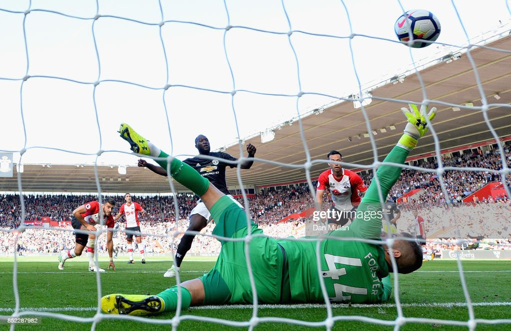 Romelu Lukaku of Manchester United scores his sides first goal past Fraser Forster of Southampton during the Premier League match between Southampton and Manchester United at St Mary's Stadium on September 23, 2017 in Southampton, England.