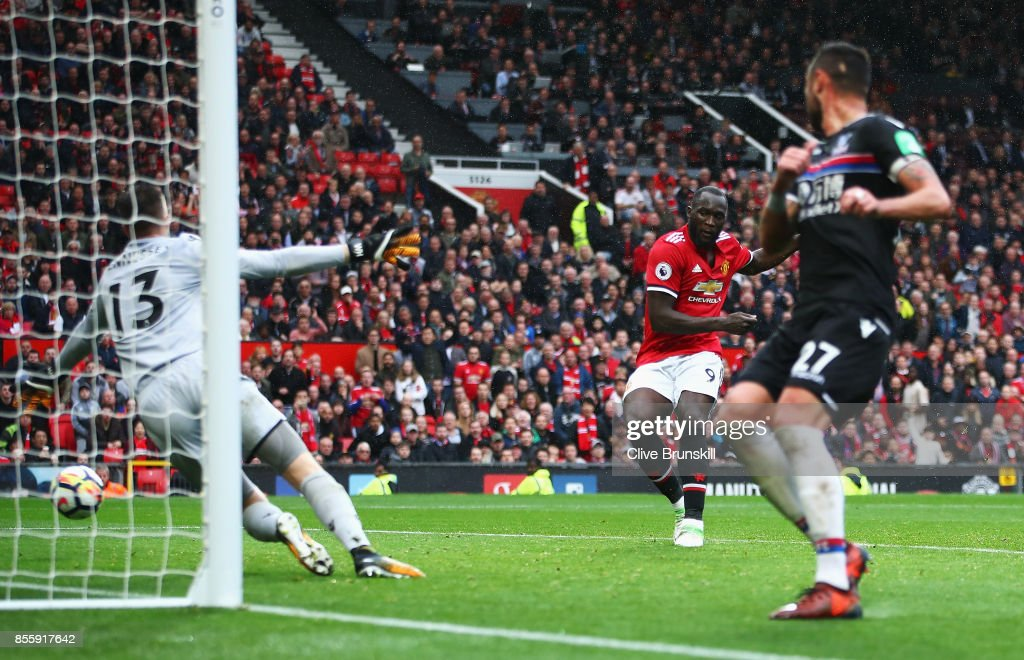 Romelu Lukaku (C) of Manchester United scores his side's fourth goal during the Premier League match between Manchester United and Crystal Palace at Old Trafford on September 30, 2017 in Manchester, England.