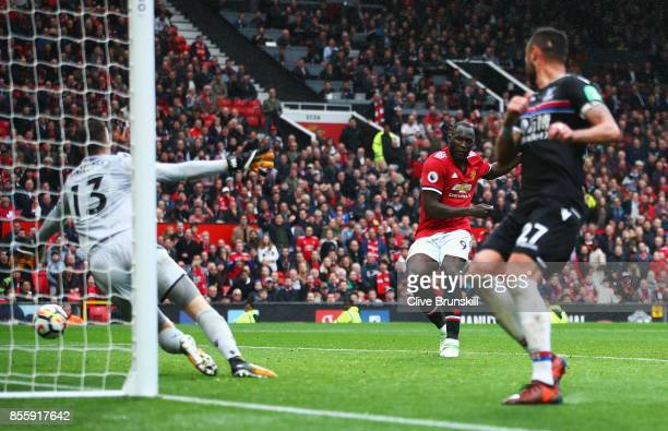 Romelu Lukaku of Manchester United scores his side's fourth goal during the Premier League match between Manchester United and Crystal Palace at Old...