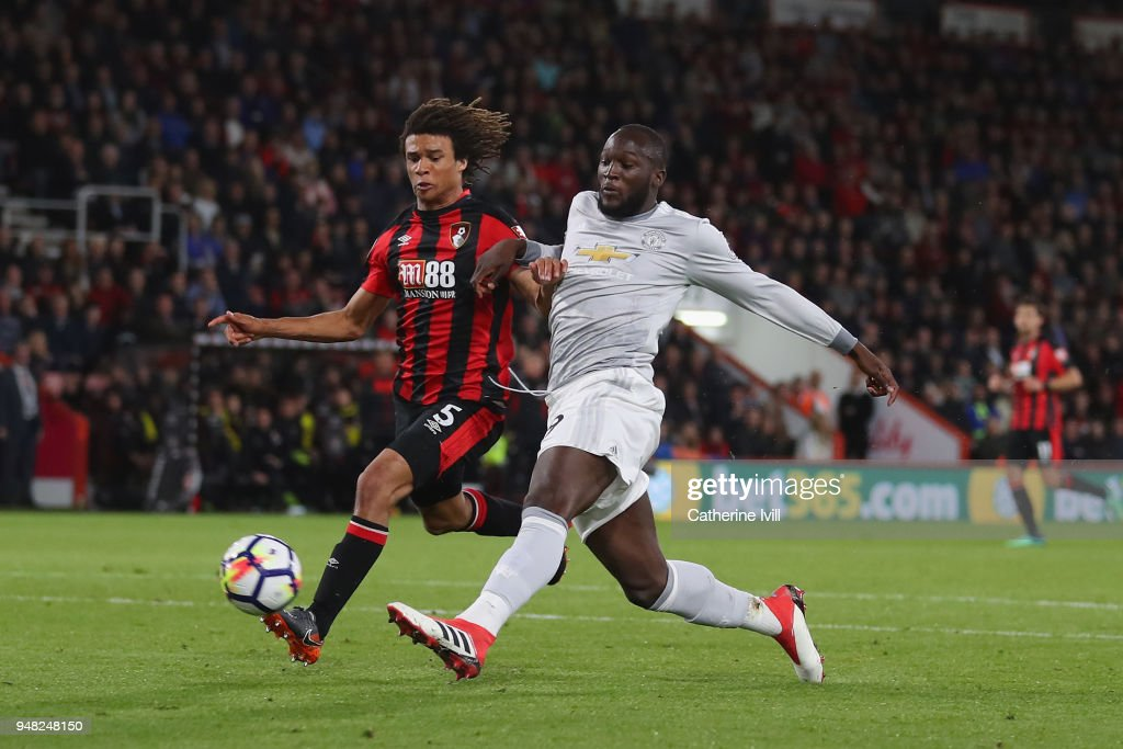 Romelu Lukaku of Manchester United scores his sides second goal past Nathan Ake of AFC Bournemouth during the Premier League match between AFC Bournemouth and Manchester United at Vitality Stadium on April 18, 2018 in Bournemouth, England.