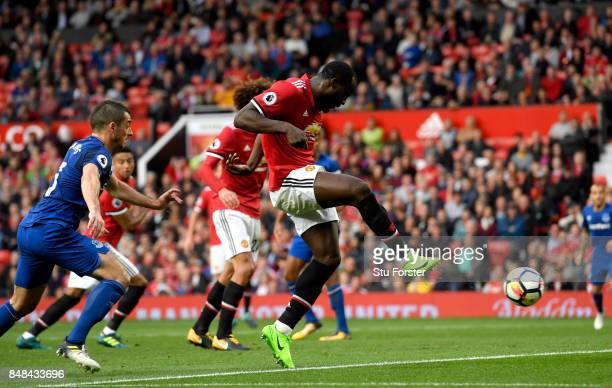 Romelu Lukaku of Manchester United scores his sides third goal during the Premier League match between Manchester United and Everton at Old Trafford...