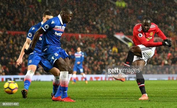 Romelu Lukaku of Manchester United scores his sides third goal during the Premier League match between Manchester United and Stoke City at Old...