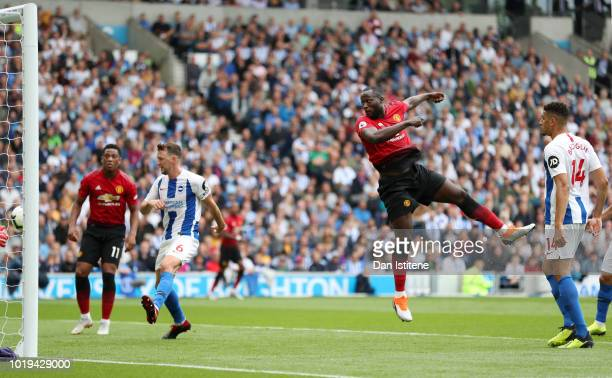 Romelu Lukaku of Manchester United scores his team's first goal during the Premier League match between Brighton Hove Albion and Manchester United at...