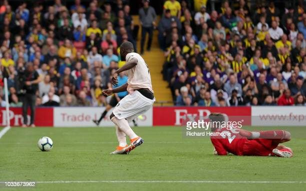 Romelu Lukaku of Manchester United scores his team's first goal during the Premier League match between Watford FC and Manchester United at Vicarage...