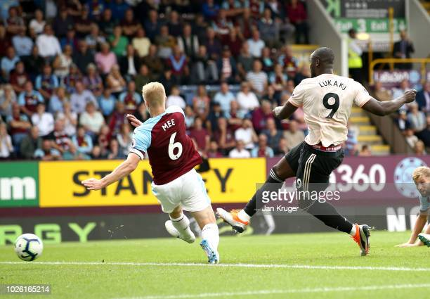 Romelu Lukaku of Manchester United scores his team's second goal past Ben Mee of Burnley during the Premier League match between Burnley FC and...