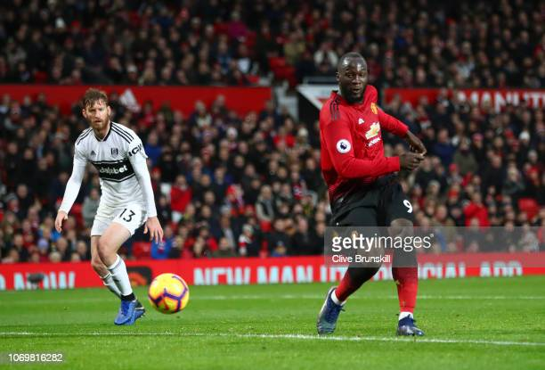 Romelu Lukaku of Manchester United scores his team's third goal during the Premier League match between Manchester United and Fulham FC at Old...